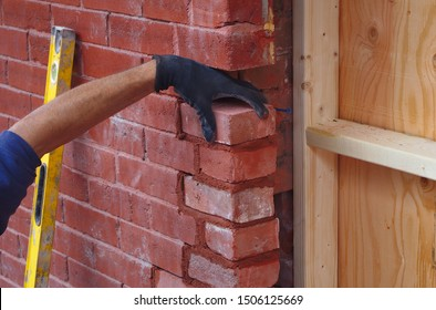 mason builder hand working brick wall construction