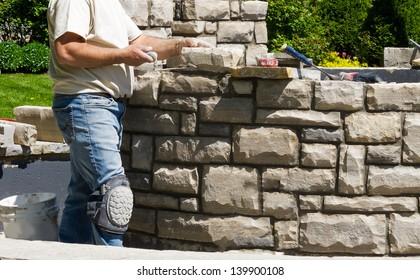 Mason building stone wall