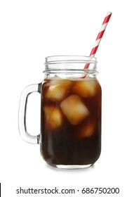 Mason jar with cold brew coffee and ice on white background