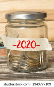 Mason jar, EUro coins and labels with the imprint 2020