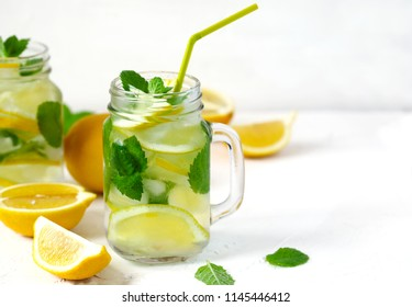Mason jar glass of lemonade with mint on white background, copy space