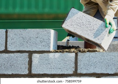 Mason on laying bricks.HOME BUILDING & RENOVATION