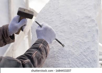 Mason at work stone carving.