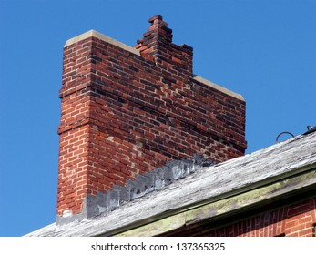Masonry chimney in disrepair, sorely in need of pointing and/or tuckpointing