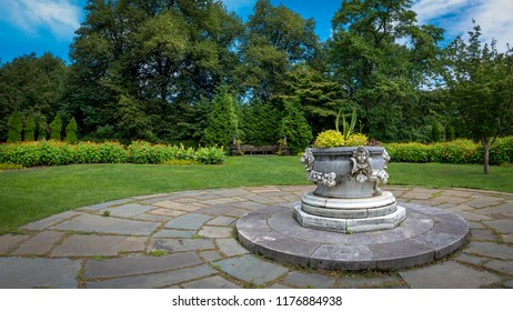 Masonry planter on a circular patio in a formal garden