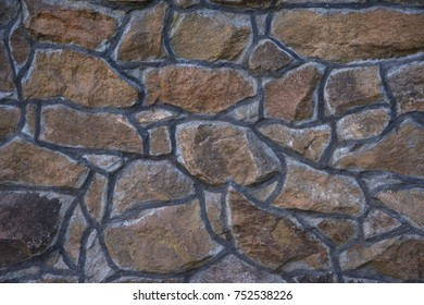 masonry slate facade wall background with cement joints antique. natural stone
