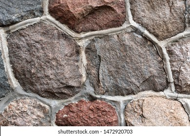 Masonry stone abstract texture on ancient foundation of cathedral. Old tile pattern.