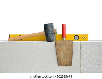 Masonry tools on white wall. Bricklaying work.