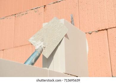mason's trowel on masonry