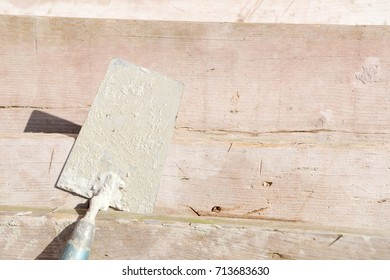 mason's trowel on scaffolding plate