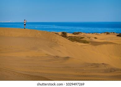 Maspalomas, Gran Canaria - NOVEMBER 22, 2017: View of the Maspalomas dunes, and sea.
