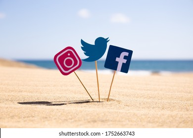 MASPALOMAS, GRAN CANARIA - OCTOBER, 2019: Facebook, Twitter and Instagram icons on sticks on sandy beach at sunny day