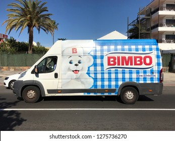 Maspalomas, Gran Canaria, Spain - January 4, 2019: Bimbo delivery van, and unknown and unrecognizable driver, passing by on a public road in the Spanish city of Maspalomas.