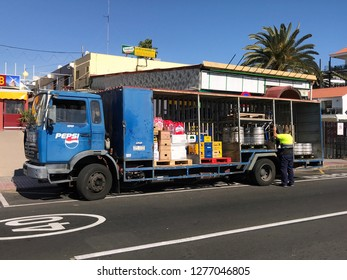 Maspalomas, Gran Canaria, Spain - January 4, 2019: Pepsi delivery truck, and unknown and unrecognizable delivery man, by the side of a public road in the Spanish city of Maspalomas.