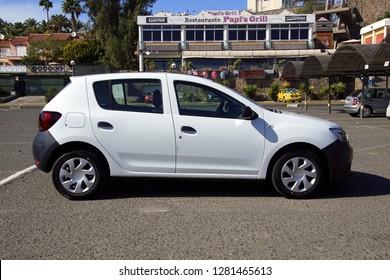 Maspalomas, Gran Canaria, Spain - January 4, 2019: White Dacia Sandero parked on a public parking lot. Nobody in the vehicle.