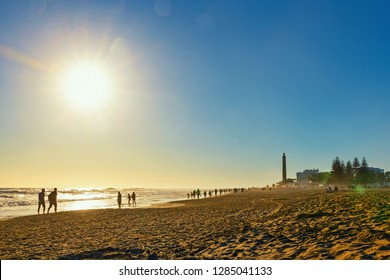 Maspalomas lighthouse and tourists on the beach, Gran Canaria