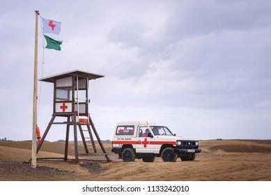 MASPALOMAS, SPAIN. Jan. 28, 2018: Beach safety guards of Spanish red cross (Cruz Roja) in jeep on the beach in Maspalomas.