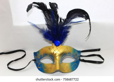 Masquerade mask decorated with blue feathers, sequins, sequins