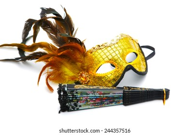 Masquerade  mask and  fan isolated on a white background