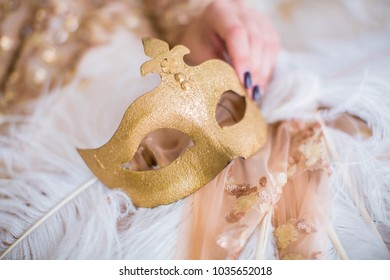 Masquerade venetian carnival golden mask, with long white feathers