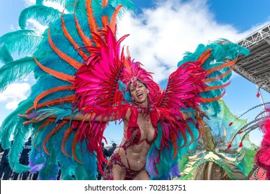 A masquerader enjoys herself at the Socadrome for Carnival Tuesday 2017 in the band called Tribe Bliss in Trinidad and Tobago.
