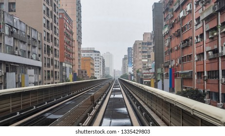 Mass Rapid Transit (MRT) track with modern building in the city, transportation in Taipei, Taiwan