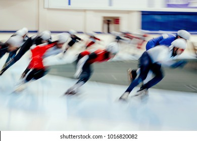 mass start men athletes ice skaters blurred motion