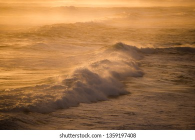 The mass of wave were spreding to a shore in warm shiny subset