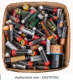 MASSA CARRARA, ITALY – APRIL 5, 2019: Studio isolated box of small domestic dry cell batteries, old trash to recycle on white. Alkaline. Europe, UK AA and AAA size.