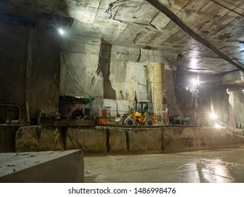 MASSA CARRARA, ITALY - AUGUST 23, 2019: Most marble quarries are open cast type but some are underground. Here is inside of one such.