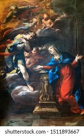 Massa Marittima, Italy - June 23, 2019: Massa Marittima, Grosseto, Tuscany, Italy: interior of the medieval cathedral (Duomo). Painting by Raffaello Vanni: Annunciazione (1643)
