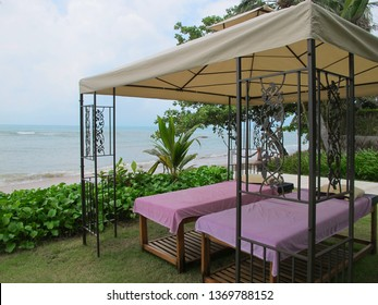 Massage beds by the sea. Two massage table under a canopy in nature. Massage services for holidaymakers. Health and recreation.