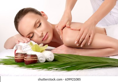 Massage . Body care. Spa body massage treatment. Woman having massage in the spa salon