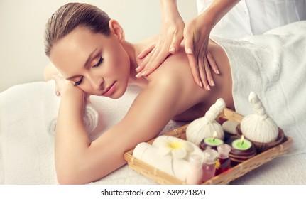 Massage.  Body care. Spa body massage treatment. Woman having massage in the spa salon