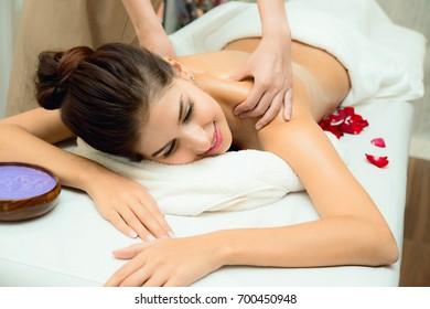 Massage and body care. Spa body massage treatment. Woman having massage in the spa salon.