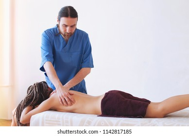 Massage and body care - young woman getting spa massage treatment at beauty spa salon