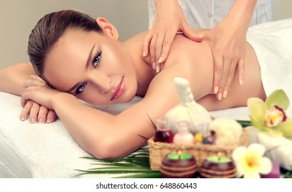 Massage and body ody care. Spa body massage   woman hands treatment. Woman having massage in the spa salon for beautiful girl