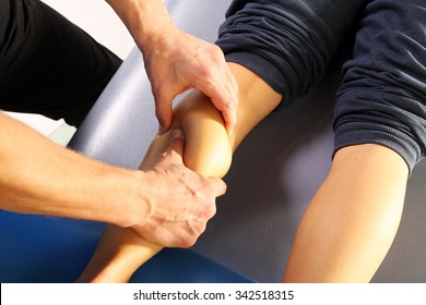 Massage calf muscle massager oppresses. Masseur massaged his calf.