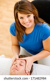 Massage: Cheerful Therapist At Work