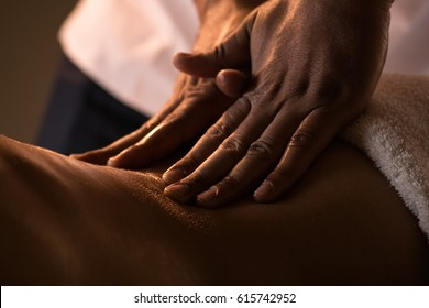 Massage closeup with hands of professional masseur
