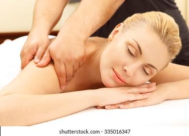 Massage day. Horizontal portrait of a beautiful woman enjoying her massage session