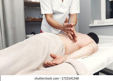 Massage doctor. The man is undergoing rehabilitation