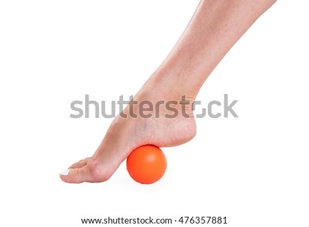 Massage feet with a rubber ball in orange on an isolated white background.