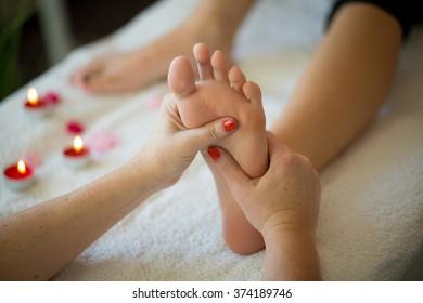 Massage of female foot in Spa Salon
