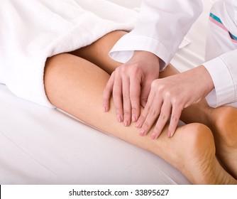 Massage of female leg. Spa resort.