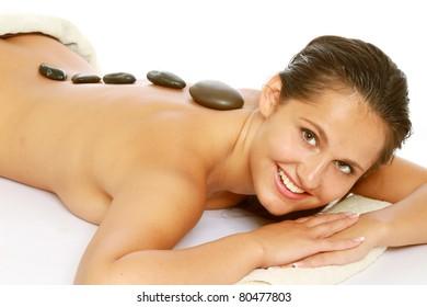 Massage with hot stone