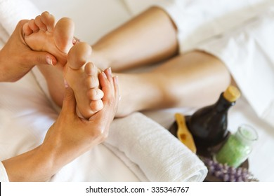 Massage of human foot in spa salon. Close up