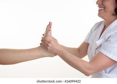 Massage of human foot in a spa salon by a female beautician