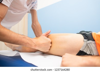 Massage lata band to an athlete by a physiotherapist.