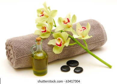 massage oil and orchids on towel isolated